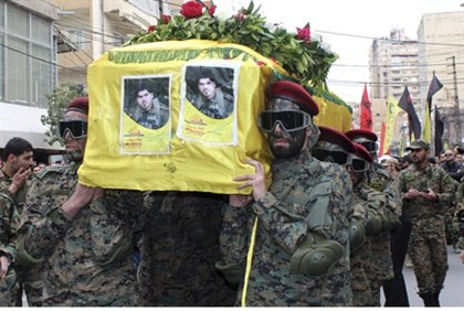 Hezbollah members carry the coffin of a fighter killed in the battle for Yabroud, Syria