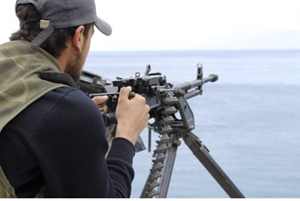 Syrian rebel on the lookout for regime gunboats near the coastal town of Kasab