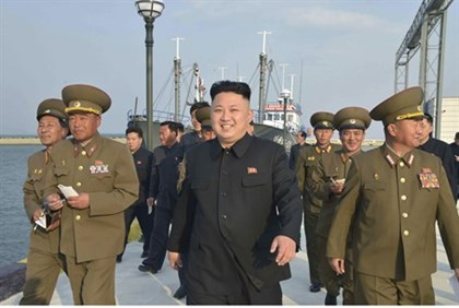 Kim Jong-Un with note-takers