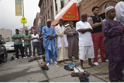 Muslim men pray outside a mosque in Brooklyn, New York
