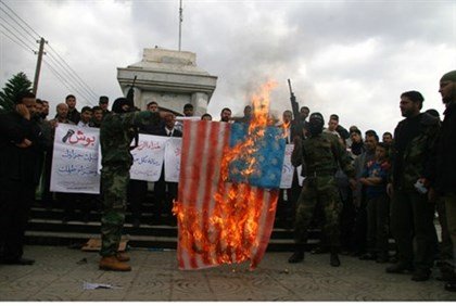 Negotiating? Hamas terrorists burn an American flag, 2008
