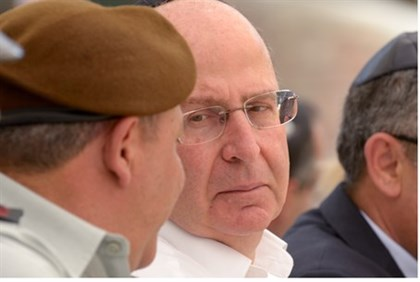 Yaalon (R) speaks to officers during Memorial Day ceremony