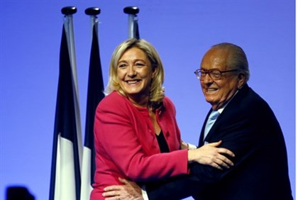 Le Pen with his daughter and current FN leader Marine Le Pen