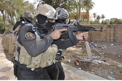 Iraqi security forces (pictured) were forced from Mosul by ISIS