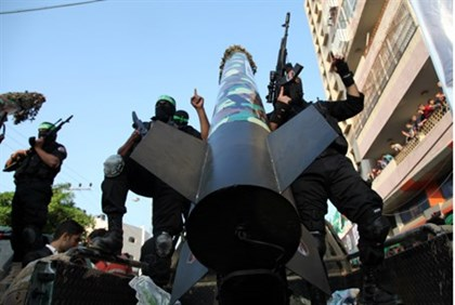 Gaza terrorists parade rocket