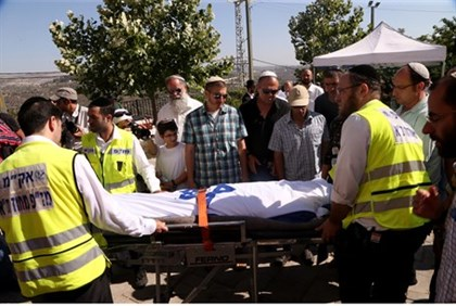 The body of Gilad Sha'ar is transported from his hometown of Talmon for burial in Modiin