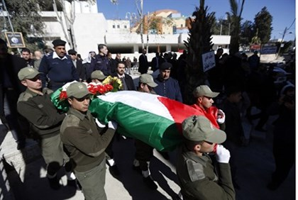 PA security forces escort Jamal al-Jamal's body for burial in Ramallah