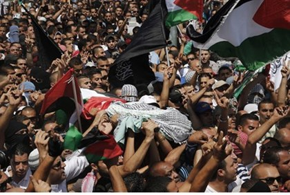 Mourners carry the coffin of Mohammed Abu-Kder in Jerusalem