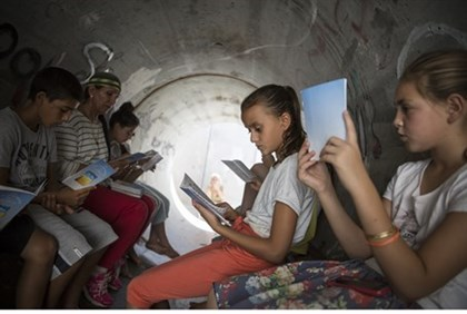 Children sit in a bomb shelter in the southern Israeli town of Nitzan