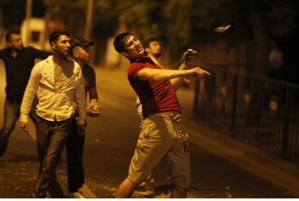 Demonstrator throws rocks at Israeli embassy in Ankara