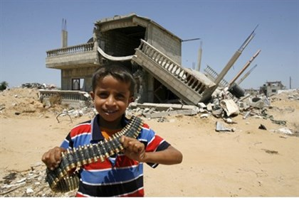 Arab child holds bullets in Gaza