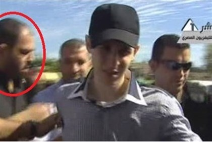 Attar (circled) seen with kidnapped IDF soldier Gilad Shalit
