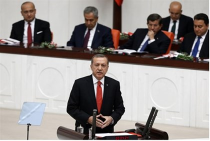 Turkish President Recep Tayyip Erdogan addresses parliament