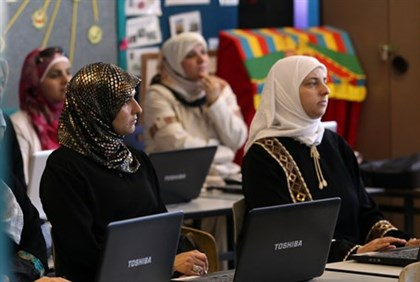 Arab women on computers (illustration)
