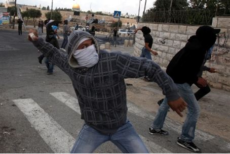Arab Nakba Day rioter hurls rock (file)