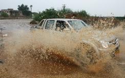 Car plows through rare heavy rain in Eilat