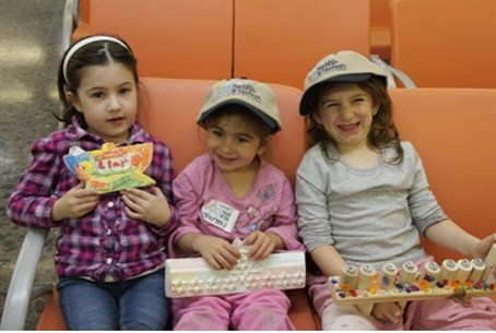 Three young olim prepare for Chanukah