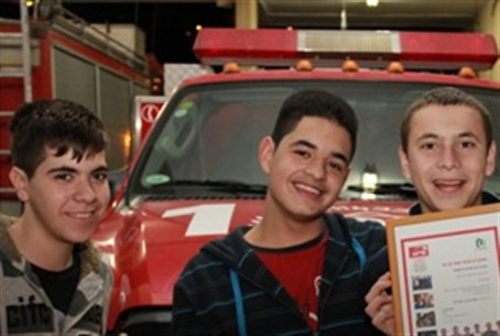 OU youth receive  certificate from firemen