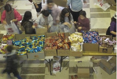 ZOA volunteers packing Mishloach Manot