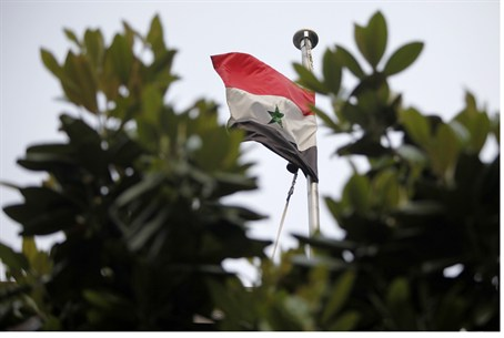 Syrian flag flying above embassy in Tokyo