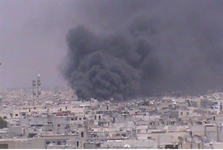 Smoke rises from Homs