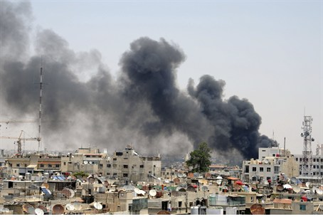 Smoke rises after bombing at Syrian Palace of