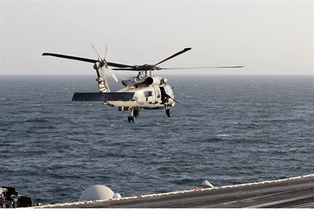 Helicopter flies over Strait of Hormuz