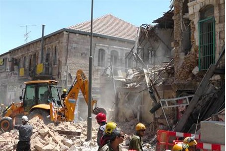 Building debris after wall collapses in Jeru