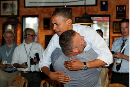 Obama is hugged and picked up by Scott Van Du
