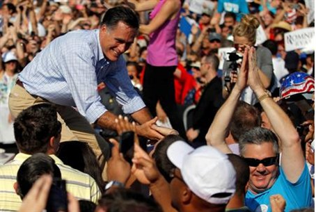 Mitt Romney greets the audience at a campaign