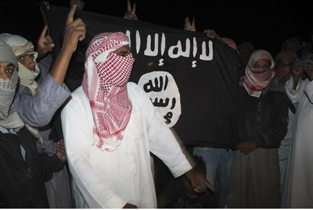protesters carry an al Qaeda flag that reads: