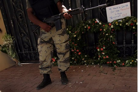 A Libyan security force stands guard at the m