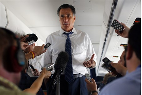 Romney talks to reporters about his phone con