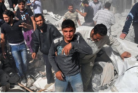 Syrian men react following an airstrike by Sy