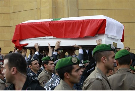 The coffins of Wissam al-Hassan and his bodyg
