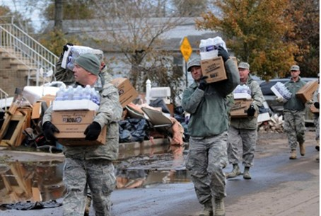 New York Army Guard takes water and food to r