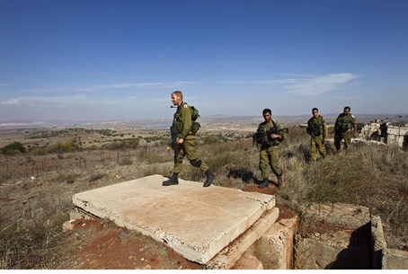 Israeli soldiers patrol the area near the Syr