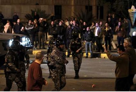 Jordanian police face rioters
