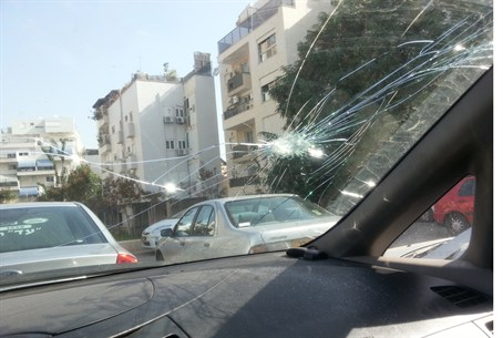 Vehicle damaged by rock attack