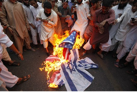 terrorists burn Israeli, American flags