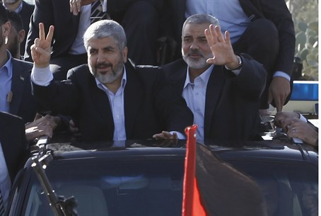 Hamas chief Khaled Mashaal and Hamas PM Ismai