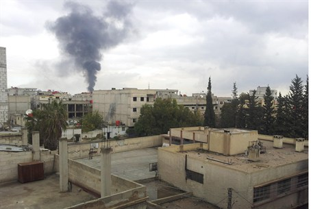 Smoke rises near Damascus