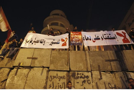 Anti-Mursi protesters shout slogans on top of