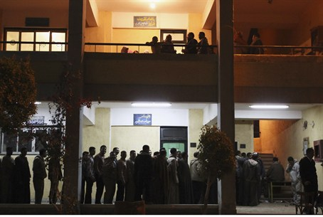 People queue outside a polling station the fi