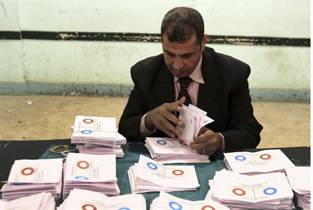 An official counts ballots in Egypt referendu