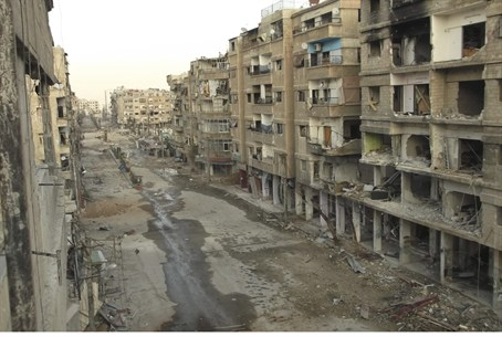 Buildings damaged by missiles fired by Syrian
