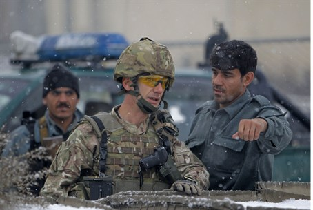 Afghan policemen and a NATO soldier
