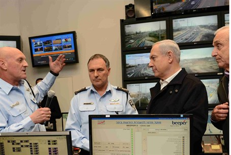 Netanyahu being briefed at Beit Dagan