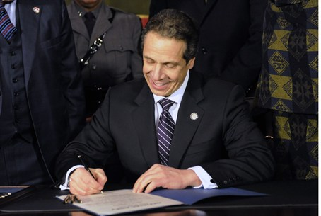 New York Governor Andrew Cuomo signs the New