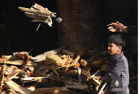 Boy carries firewood in Damascus's Duma neigh